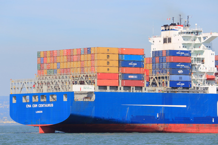 SAN FRANCISCO, USA - APRIL 8, 2014: CMA CGM Centaurius container ship sails in San Francisco bay. CMA CGM is the 3rd largest container shipping company in the world with 170 routes.