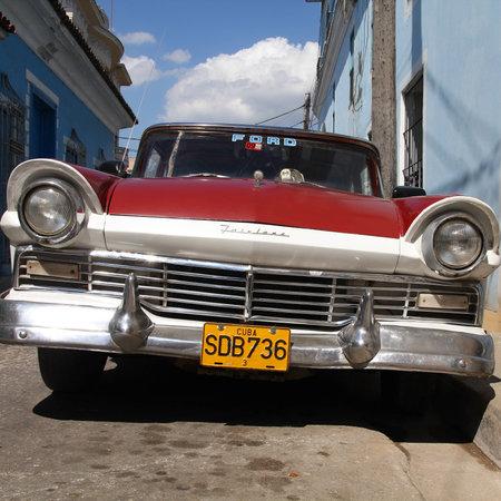 capita: SANCTI SPIRITUS, CUBA - FEBRUARY 6, 2011: Classic American car in the street in Sancti Spiritus, Cuba. Cuba has one of the lowest car-per-capita rates (38 per 1000 people in 2008).