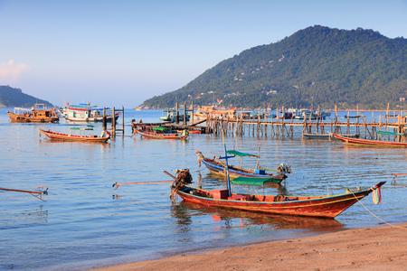 koh tao: Thailand, Southeast Asia - Koh Tao island in Surat Thani province. Boat harbor in sunset light.