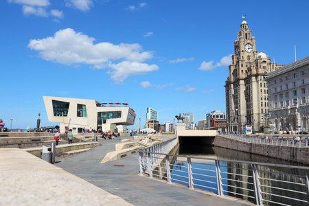 LIVERPOOL, UK - APRIL 20: People visit Pier Head area on April 20, 2013 in Liverpool, UK. Pier Head is part of Liverpools famous UNESCO World Heritage Site.
