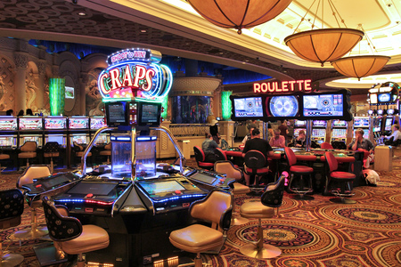 LAS VEGAS, USA - APRIL 14, 2014: People visit Caesars Palace casino resort in Las Vegas. The famous casino resort has almost 4,000 rooms.