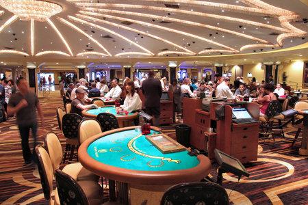 LAS VEGAS, USA - APRIL 14, 2014: People visit Caesars Palace casino resort in Las Vegas. The famous casino resort has almost 4,000 rooms.