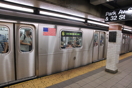 NEW YORK, USA - JULY 3, 2013: People ride a subway train in New York. With 1.67 billion annual rides, New York City Subway is the 7th busiest metro system in the world.