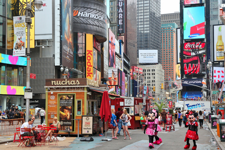 new york times: NEW YORK, USA - JULY 3, 2013: People visit Times Square in New York. Times Square is one of most recognized landmarks in the world. More than 300,000 people pass through Times Square daily.