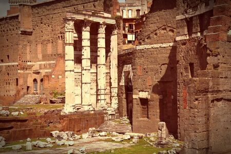 cross processed: Ancient Roman ruins in Foro Traiano (Trajans Forum). Cross processed color style - retro image filtered tone.