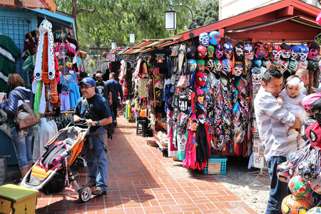 old street: LOS ANGELES, USA - APRIL 5, 2014: People visit Olvera Street in Los Angeles. Olvera Street is the oldest part of downtown LA. It is California State Historic Landmark since 1953.