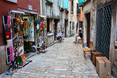 ROVINJ, CROATIA - JUNE 19, 2011: People visit the old town in Rovinj, Croatia. In 2011 11.2 million tourists visited Croatia, most of them in summer.