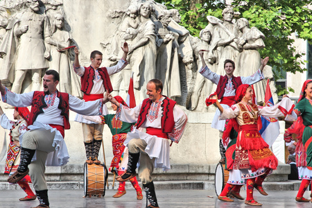 BUDAPEST, HUNGARY - JUNE 19, 2014: Bulgarian folk dance group JANTRA performs on street in Budapest. The group performs since 1996.