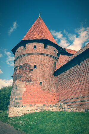 teutonic: Malbork castle in Pomerania region of Poland. Teutonic Knights fortress also known as Marienburg. Cross processed color tone - retro filtered style.