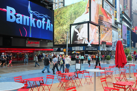 new york times: NEW YORK, USA - JUNE 10, 2013: People visit Times Square in New York. Times Square is one of most recognized landmarks in the world. More than 300,000 people pass through Times Square daily.