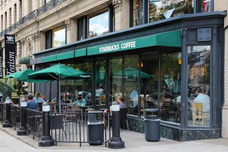 WASHINGTON, USA - JUNE 14, 2013: People relax at Starbucks Coffee in Washington, DC. Starbucks is the largest coffee house company in the world, it has 20,891 stores in 62 countries.