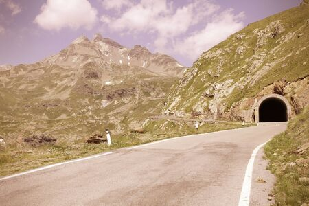 gavia: Italy, Stelvio National Park. Famous road to Gavia Pass in Ortler Alps. Alpine landscape. Cross processing color style - retro filtered tone.