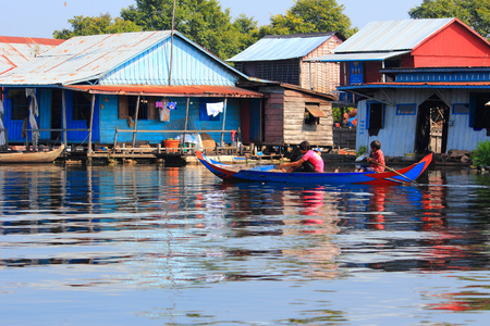 tonle sap: TONLE SAP, CAMBODIA - DECEMBER 11, 2013: Unidentified people go about their daily life in floating village on Tonle Sap lake. It is the largest lake in Southeast Asia (up to 16,000 square km). Editorial