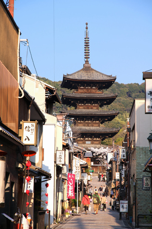 KYOTO, JAPAN - APRIL 17, 2012: People visit old town of Gion district, Kyoto, Japan. Old Kyoto is a UNESCO World Heritage site and was visited by almost 1 million foreign tourists in 2010.