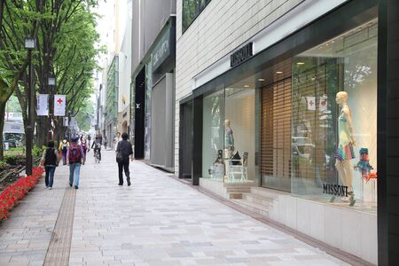lvmh: TOKYO, JAPAN - MAY 9, 2012: People shop in Omotesando district in Tokyo. Omotesando is considered one of most important shopping areas in Tokyo, the largest city in the world. Editorial