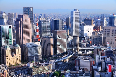 OSAKA, JAPAN - APRIL 27, 2012: Cityscape view in Osaka, Japan. Osaka is the 3rd largest city in Japan (2.8 million people) with population of metro area reaching 19 million people.