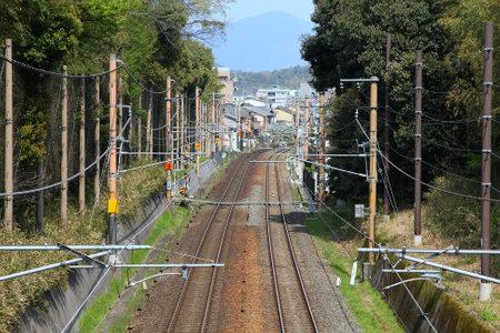 railway transportation: Kyoto, Japan - railroad tracks. Railway transportation infrastructure with electric lines. Editorial