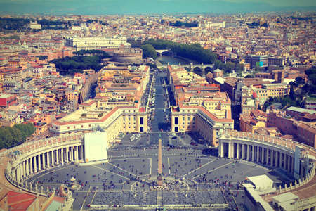 Rome, Italy. Famous Saint Peters Square in Vatican and aerial view of the city. Cross processed color style - retro image filtered tone. photo