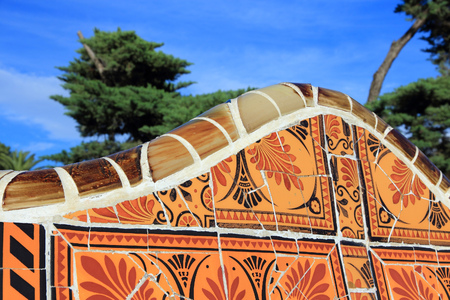 trencadi: BARCELONA, SPAIN - NOVEMBER 6, 2012: Ceramic art in Park Guell in Barcelona, Spain. It was built in 1900-14 and  is part of the UNESCO World Heritage Site Works of Antoni Gaudi. Editorial