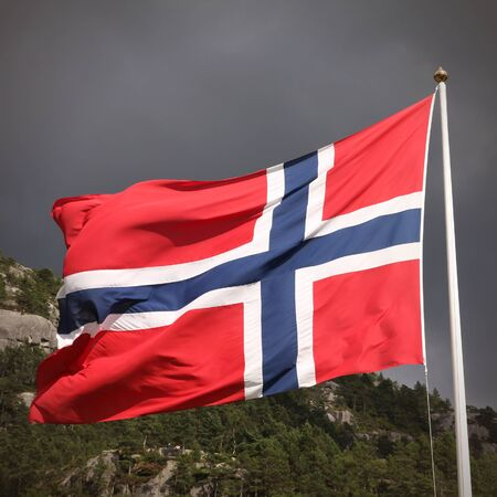 Flag of Norway - national symbol with nature in the background. Square composition. photo