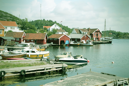 kristiansand: Norway - Skjernoy island in the region of Vest-Agder. Small fishing town - Farestad. Cross processed color tone - retro image filtered style.