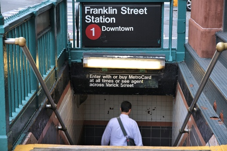 1 person: NEW YORK, USA - JULY 1, 2013: Person enters subway station in New York. With 1.67 billion annual rides, New York City Subway is the 7th busiest metro system in the world.