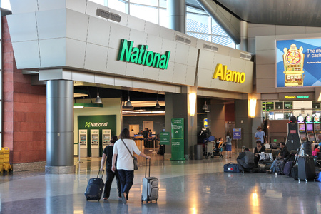 LAS VEGAS, USA - APRIL 13, 2014: Alamo and National car rental airport office in Las Vegas. Both brands are owned by Enterprise Holdings, company employing 74,000 people (2013). Editorial