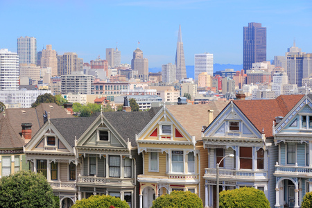 San Francisco, California, United States - city skyline with famous Painted Ladies, Victorian homes at Alamo Square (Western Addition neighborhood).