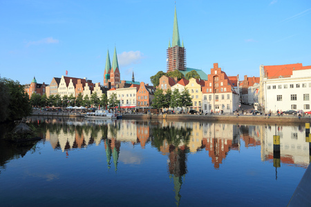 apartment tower old town: Lubeck in region Schleswig-Holstein, Germany. Hanseatic City. Old Town water reflection.
