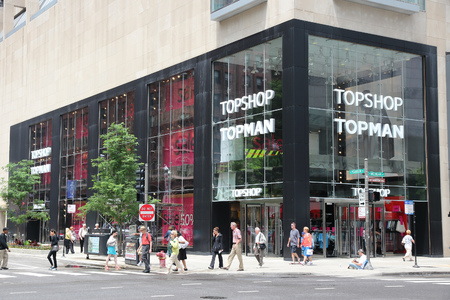 magnificent mile: CHICAGO, USA - JUNE 26, 2013: People walk by Topshop Topman store at Magnificent Mile in Chicago. The Magnificent Mile is one of most prestigious shopping districts in the United States.