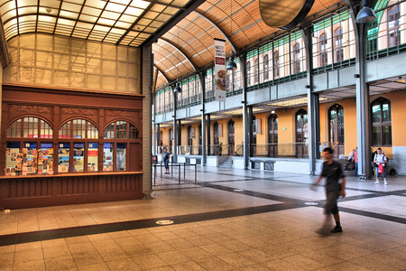 WROCLAW, POLAND - JULY 6, 2014: People visit Wroclaw Glowny railway station in Wroclaw. The building dates back to 1857. It is the busiest station in Wroclaw. Editorial