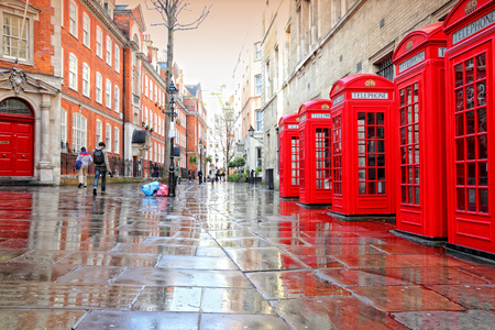 LONDON, UK - MAY 13, 2012: People visit Broad Court in rainy London. With more than 14 million international arrivals in 2009, London is the most visited city in the world (Euromonitor).