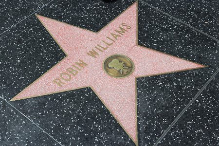 LOS ANGELES, USA - APRIL 5, 2014: Robin Williams star at famous Walk of Fame in Hollywood. Hollywood Walk of Fame features more than 2,500 stars with inscribed celebrity names.