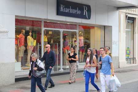 retailer: CURITIBA, BRAZIL - OCTOBER 7, 2014: People shop at Riachuelo in Curitiba, Brazil. Riachuelo has 230 department stores in Brazil and employs 40,000 people.