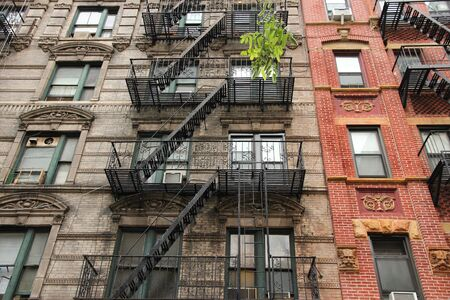 New York City, United States - old residential buildings in Chinatown district. Fire escape stairs. photo