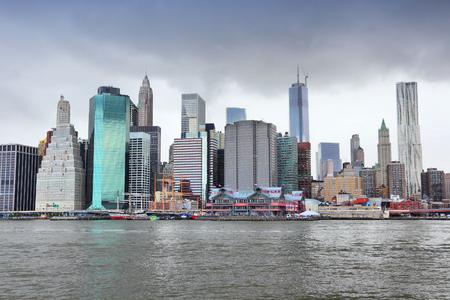 rain cloud: New York City, United States - Manhattan skyline from Brooklyn. Stormcloud sky.