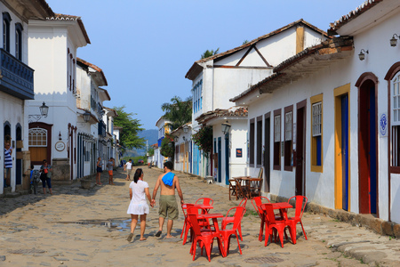 PARATY, BRAZIL - OCTOBER 14, 2014: People walk in the Old Town of Paraty (state of Rio de Janeiro). The colonial town dates back to 1667 and is considered for inclusion on UNESCO World Heritage List.