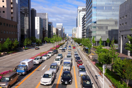 capita: NAGOYA, JAPAN - MAY 3, 2012: People drive in heavy traffic in Nagoya, Japan. With 589 vehicles per capita, Japan is among most motorized countries worldwide, which causes heavy traffic.