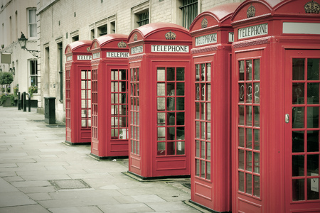 phonebooth: London, United Kingdom - red telephone boxes of Broad Court, Covent Garden. Cross processing color tone - filtered retro style.