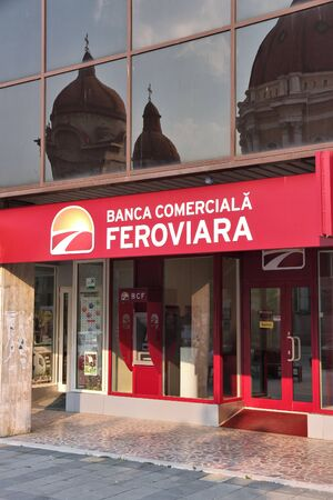 steadily: TARGU MURES, ROMANIA - AUGUST 25, 2012: Banca Comerciala Feroviara bank branch in Targu Mures. BCF was founded in 2009 and has grown steadily with 115m USD in loans in 2014.