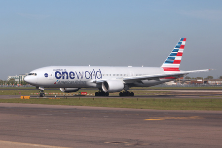 american airlines: LONDON, UK - APRIL 16, 2014: American Airlines Boeing 777 in Oneworld alliance livery after landing at London Heathrow airport. Oneworld carries more than 500 million passengers annually.