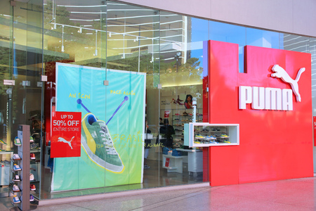 exists: LAS VEGAS, USA - APRIL 14, 2014: Puma sportswear store in Las Vegas. The German footwear company exists since 1924 and had 306 million EUR operating income in 2010.