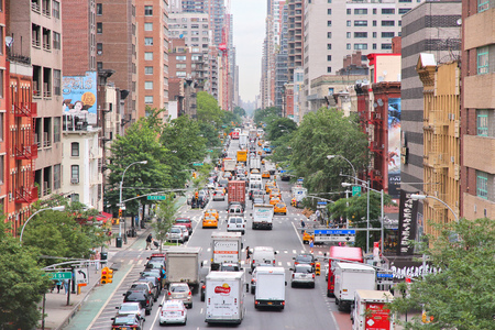 congested: NEW YORK, USA - JULY 3: People drive in heavy traffic along 1st Avenue in New York. New York is among most congested cities in America. In 2009 average American spent 34 hours in traffic jams. Editorial