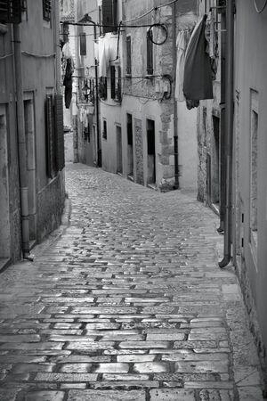 Croatia - Rovinj on Istria peninsula. Old town cobbled street. Black and white tone - retro monochrome color style. photo