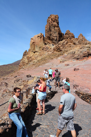 TENERIFE, SPAIN - OCTOBER 29, 2012: People visit volcanic landscape of Teide National Park in Tenerife. The 18,990 hectare national park is listed as a UNESCO World Heritage Site. Editorial