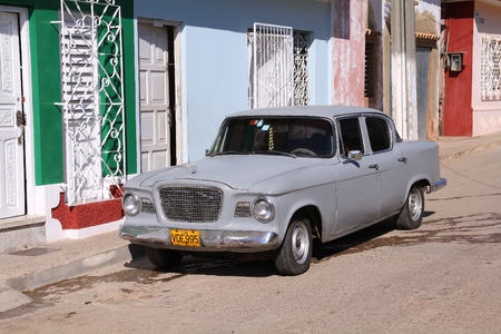 capita: TRINIDAD, CUBA - FEBRUARY 6, 2011: Oldtimer Toyota car parked in the street in Trinidad. Cuba has one of the lowest car-per-capita rates (38 per 1000 people in 2008).