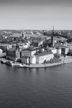Stockholm Gamla Stan, capital city of Sweden. View of famous Old Town, Stadsholmen island. Black and white tone - retro monochrome style. photo