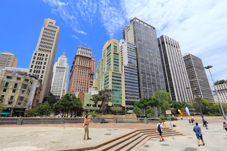 SAO PAULO, BRAZIL - OCTOBER 6, 2014: People visit downtown Sao Paulo. With 21.2 million people Sao Paulo metropolitan area is the 8th most populous in the world.