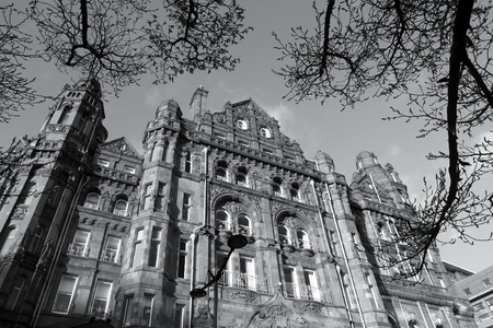 edwardian: Manchester - city in North West England (UK). Famous hotel built in eclectic Edwardian baroque architecture style. Listed building. Black and white tone - retro monochrome color style.