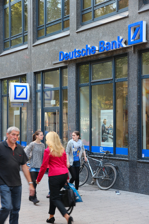 bank branch: HAMBURG, GERMANY - AUGUST 28, 2014: People walk by Deutsche Bank branch in Hamburg. Deutsche Bank is one of largest banks in the world with 98,200 employees (2013).